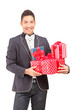 A smiling handsome guy with bow tie holding presents