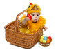 Baby in basket in chicken costume giving you Easter egg