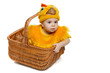 Baby sitting in Easter basket in chicken costume