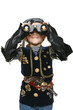 Little girl wearing costume of pirate looking through binoculars