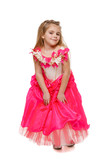 Flirty 6 years old girl in pink princess dress