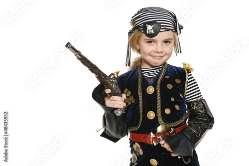 Little girl wearing pirate costume holding a gun - 48435932