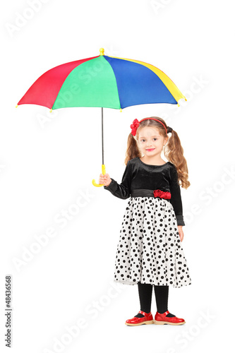 Full length portrait of a cute little girl holding a colorful um