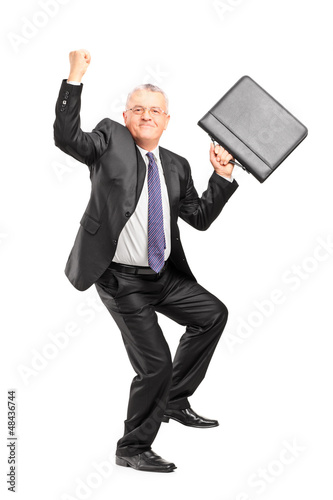 Happy mature businessperson with raised hands and briefcase