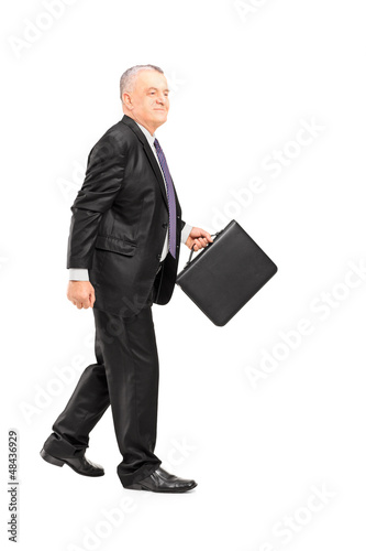 Full length portrait of a mature businessperson briefcase walkin
