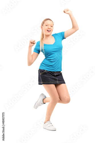 Full length portrait of an excited and happy young female