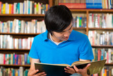 Student in library reading book