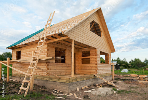 Wooden house under construction - 48437799