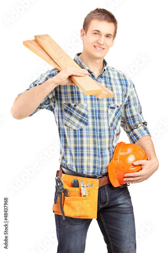 Smiling carpenter holding a helmet and sills