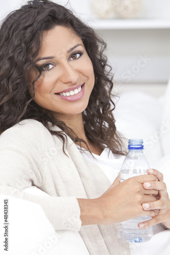 Happy Hispanic Woman Drinking Bottle of Water