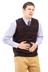 Young man having a stomach ache
