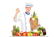 Male chef holding a bag with healthy ingridients