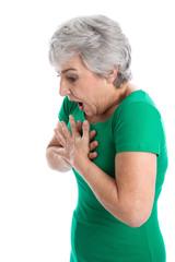 Frau isoliert in Grün hat Atemnot