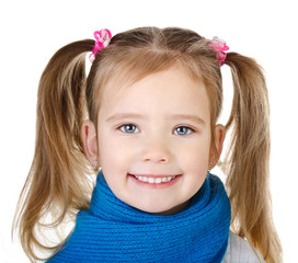 Portrait of smiling cute little girl in blue scarf