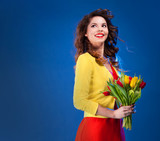 Colorful portrait of happy young woman holding flowers