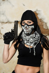 beautiful girl with weapon and mask