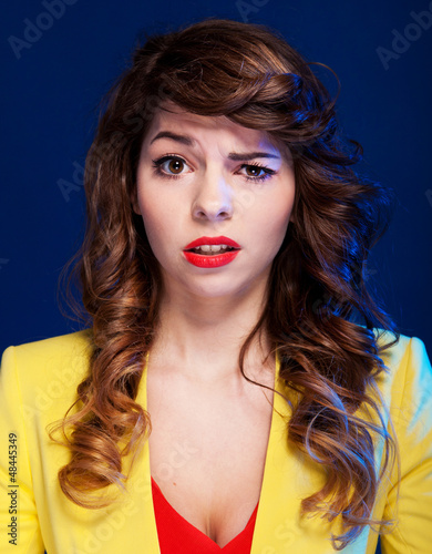 Unhappy woman looking with negative expression and disapproval.