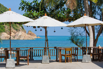 Table and chairs with a beautiful sea view , Thailand.