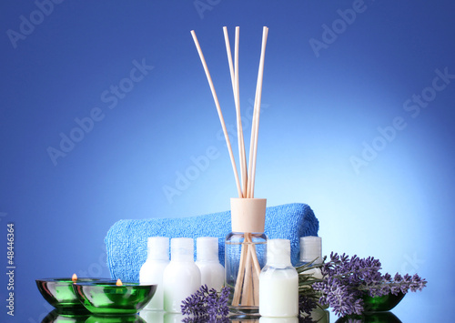 Bottle of air freshener, lavander, towel and candles