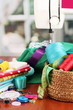 sewing machine and fabric on bright background
