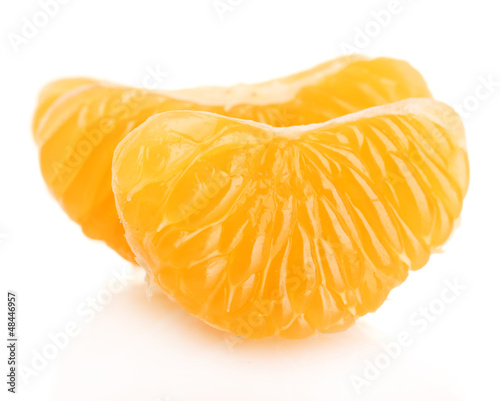 Ripe sweet tangerine  cloves, isolated on white