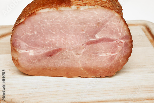 Sliced Ham on a Wood Cutting Board