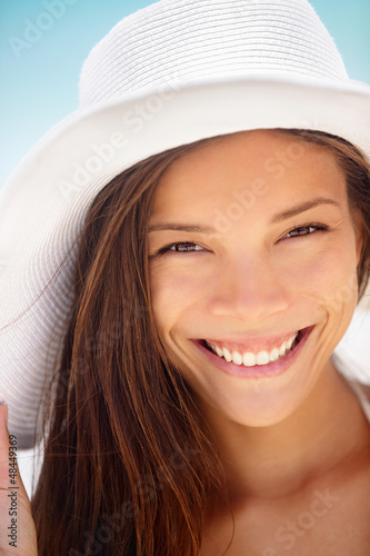Beach woman smiling - ethnic girl