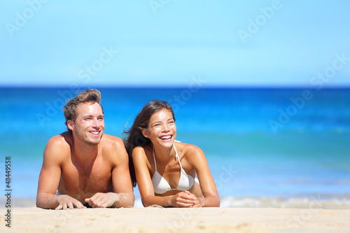 Beach couple looking