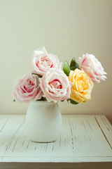 Beautiful rose bouquet on white table
