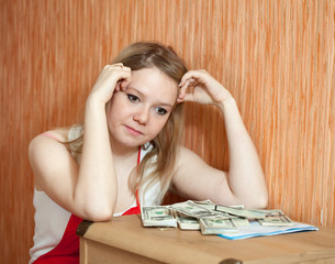 woman thinks about  financial issue