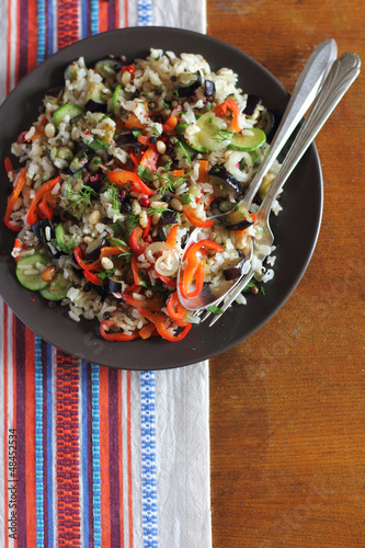 Portion of brown rice with vegetables on plate