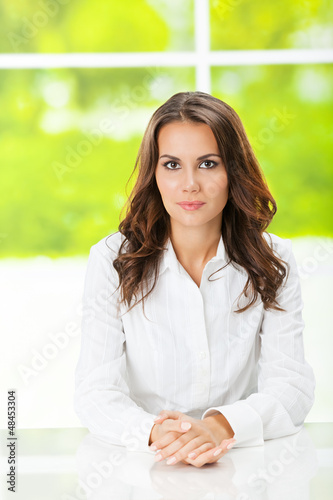 Portrait of young serious business woman at office