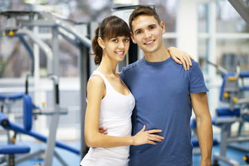 Young couple in a gym