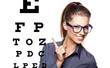woman with blue trendy glasses on the background of eye test cha