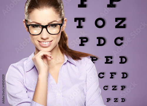 beautiful  woman with trendy glasses on the background of eye te