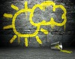 Graffiti wall with sun and cloud sign, street background