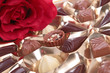 assortment of chocolate and red rose