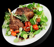 Rare fried rack of lamb isolated on black background