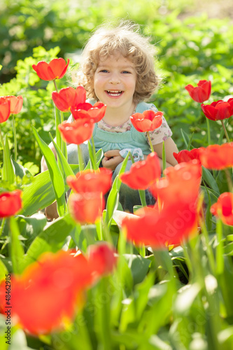Child in flowery garden