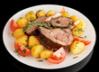 Rack of lamb with fried potatoes isolated on black