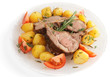 Rack of lamb with fried potatoes isolated on white