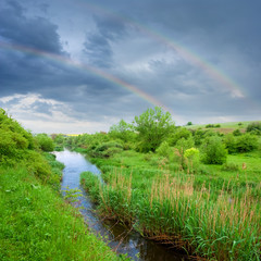 rainbow above a steppe river