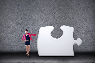 Businesswoman and missing puzzle