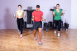 Small group of people doing bicep exercise using resistance band