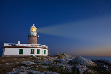 Corrubedo lighthouse at night. Province of A Coruña, Spain