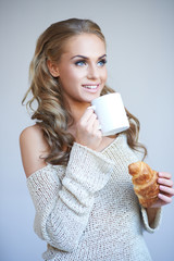 Beautiful woman enjoying a coffee break