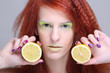 portrait of redhaired girl with lemon