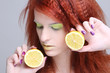 close up portrait of redhaired girl with lemon