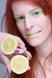 redhaired girl with lemon. close up