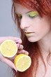 young redhaired girl with lemon. close up